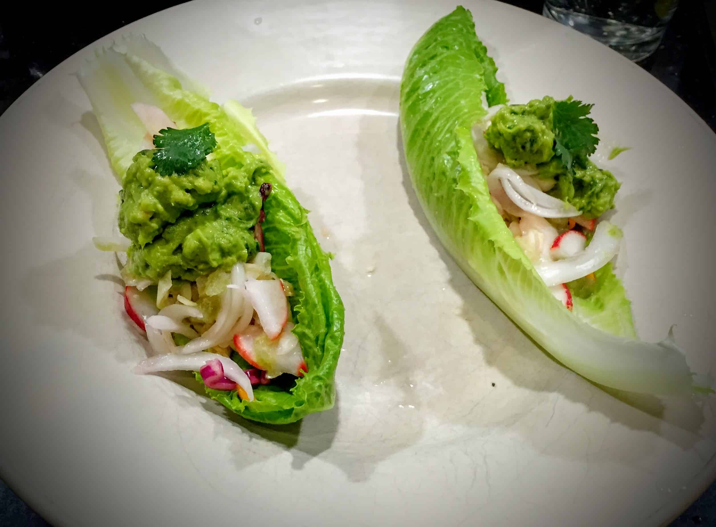 These fresh lime juice infused fish tacos are quick to make and incredibly satisfying. Not to mention healthy and very low in calories. Lime Juice is used as a base for all components, from the baked Cod with Lime-Cumin Sauce, Cabbage Radish Slaw with Lime Vinaigrette and Lime Juice based Fresh Guacamole. They are a wonderful weekday treat.