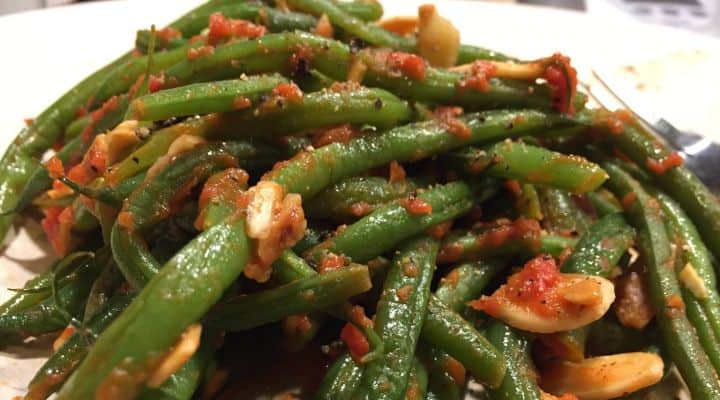 Photo of a heaping plate of our Paleo SCD green beans recipe. Green bean recipes for paleo dieters can be plain at times. This recipe puts together a delicious assembly of flavors and textures. Unlike other string beans paleo recipes, the almonds in this recipe are toasted, giving a delicious rich and smokey flavor.