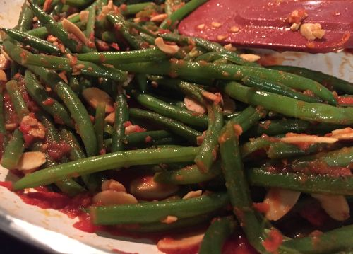 The green bean paleo recipe shown cooking here in the skillet. This is a great option to include as one of your Paleo side dish recipes. These Paleo diet green beans are kind of reminiscent of Greek green beans in tomato sauce or Italian green beans in tomato sauce.